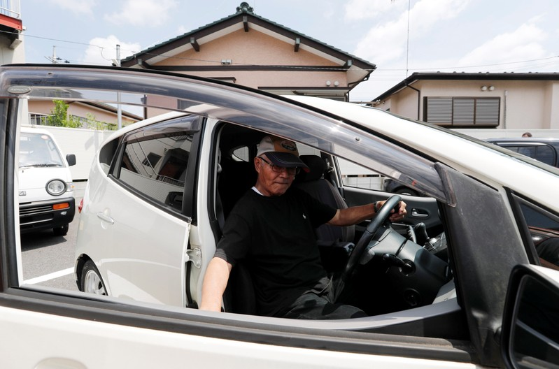 Horie Miho drives his minicar after visiting a minicar dealership in Yamato