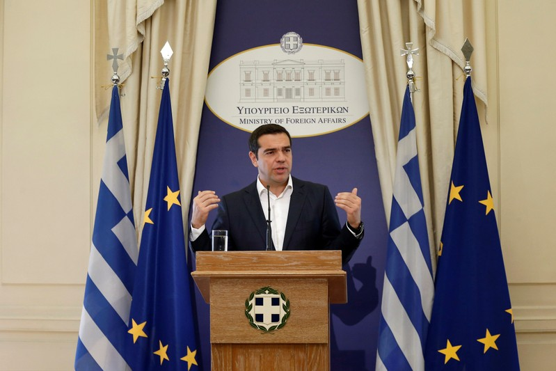 Newly appointed Greek Foreign Minister and Prime Minister Alexis Tsipras delivers a speech during a hand over ceremony at the Foreign Ministry, in Athens
