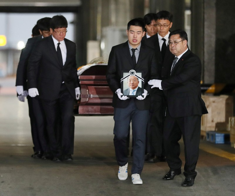 Family members mourn as the coffin carrying a body of one of the five South Korean climbers who were killed in the Himalayas is moved to a hearse, at Incheon International Airport