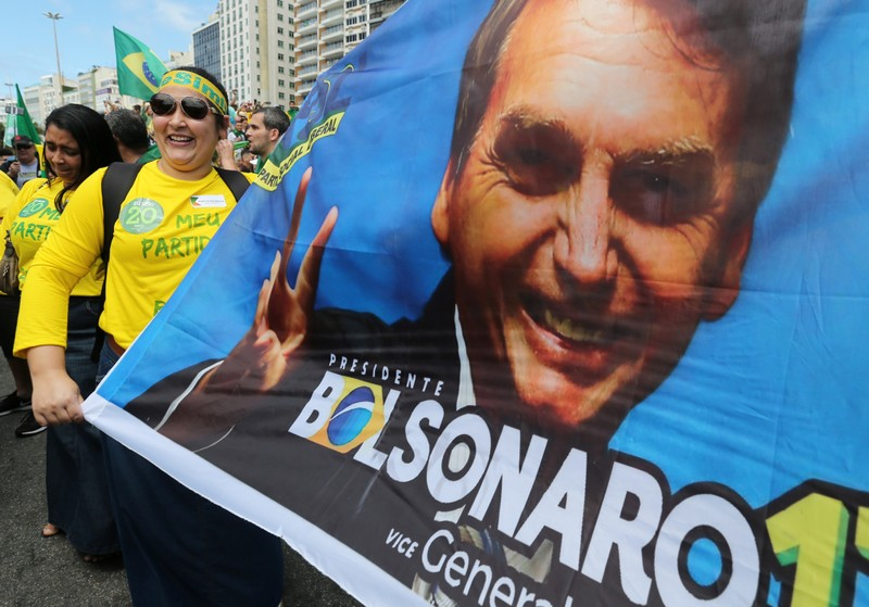 A supporter of Jair Bolsonaro, far-right lawmaker and presidential candidate of the Social Liberal Party (PSL), attends a demonstration in Rio de Janeiro