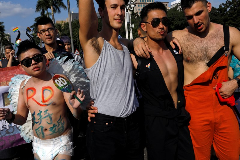 Participants take part in a LGBT pride parade to support same-sex marriage in Taipei