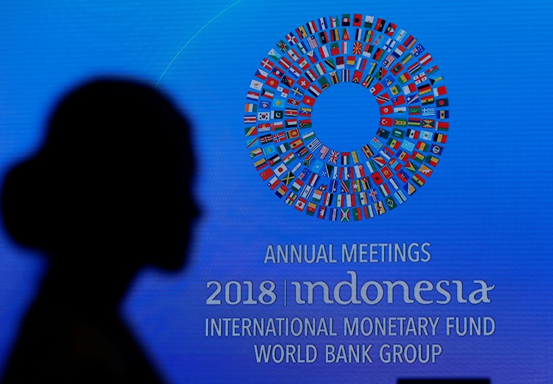 A participant attends plenary session at the International Monetary Fund - World Bank Annual Meeting 2018 in Nusa Dua