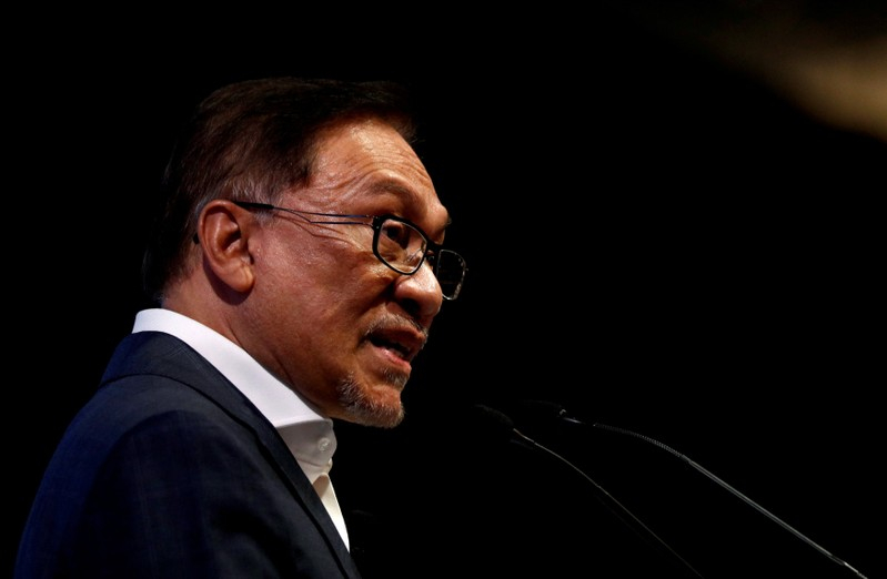FILE PHOTO: Malaysian politician Anwar Ibrahim speaks during the Singapore Summit in Singapore
