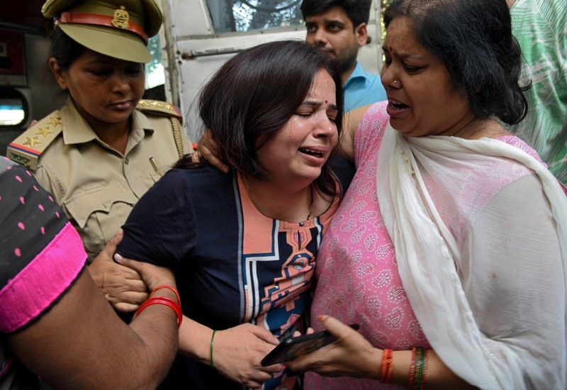 FILE PHOTO: Wife of Vivek Tiwari, a sales manager for Apple, is consoled by her relatives after her husband was shot dead by a police constable in the Gomti Nagar neighbourhood of Lucknow