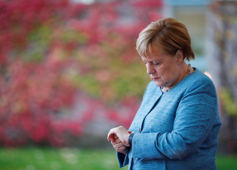 FILE PHOTO: German Chancellor Merkel awaits the arrival of participants ahead of the 'G20 Compact with Africa' summit at the Chancellery in Berlin