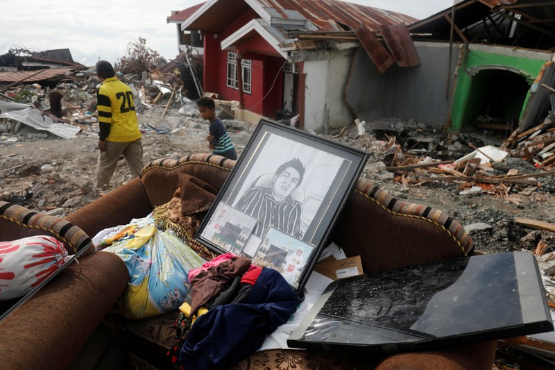 Recoverd personal items are pictured outside a home in the earthquake and liquefaction affected Balaroa neighbourhood in Palu