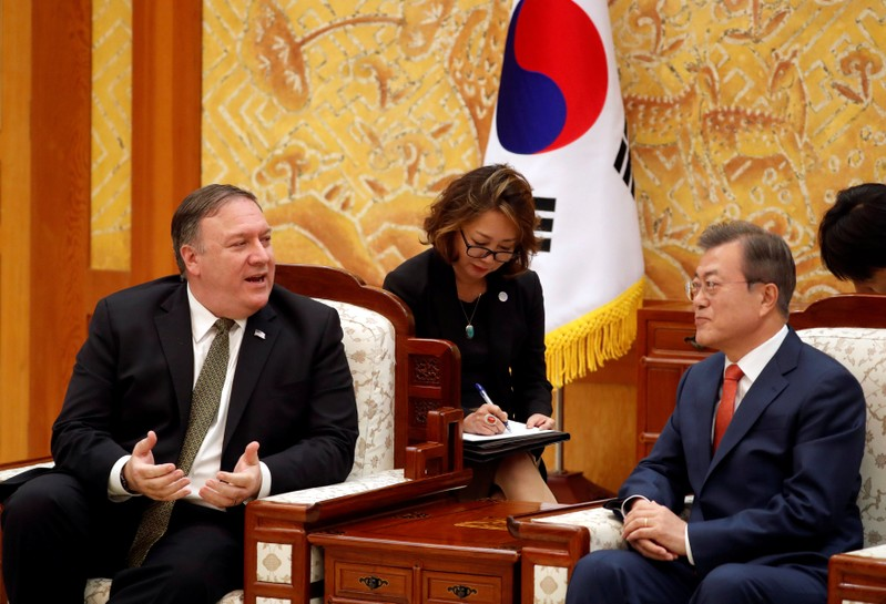 U.S. Secretary of State Mike Pompeo talks with South Korean President Moon Jae-in during their meeting at the presidential Blue House in Seoul