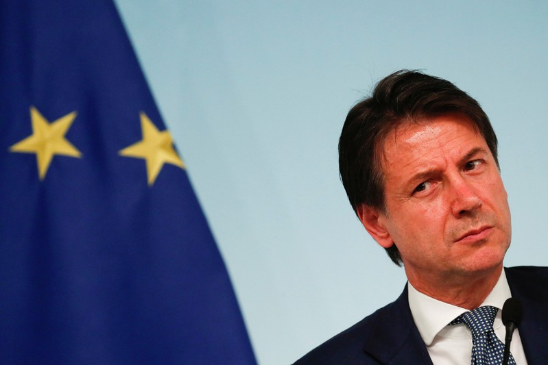 FILE PHOTO: Italy's Prime Minister Giuseppe Conte attends a news conference with Interior Minister Matteo Salvini after to approve a new decree of the measures on immigration and security at Chigi Palace in Rome