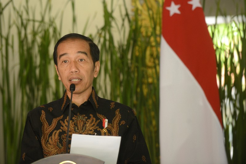 FILE PHOTO - Indonesia president Joko Widodo speaks to journalist after bilateral meeting with Singapore during the International Monitary Fund and World Bank annual meetings in Nusa Dua