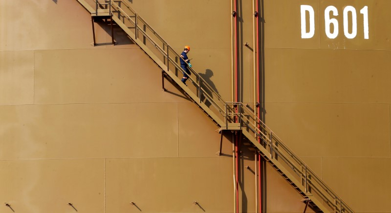 A worker walks down the stairs of an oil tank at Turkey's Mediterranean port of Ceyhan
