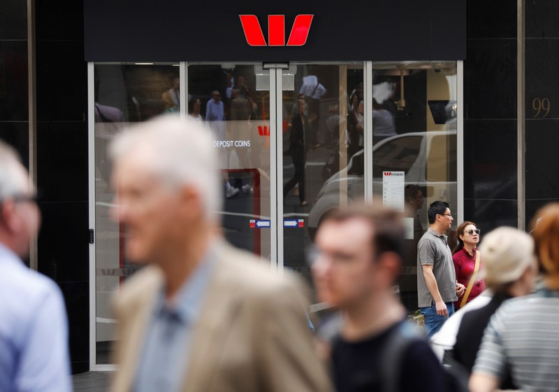 People walk past a Westpac bank branch in Sydney, Australia