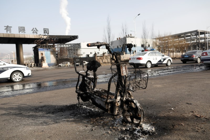 Burnt electric bicycle is pictured following a blast near a chemical plant in Zhangjiakou