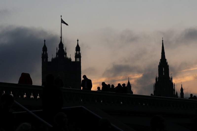 Demonstrators stand on Westminster Bridge, next to the Houses of Parliament, in London