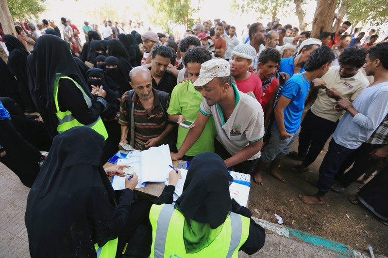 People gather at a United Nations aid distribution center in Hodeidah, Yemen