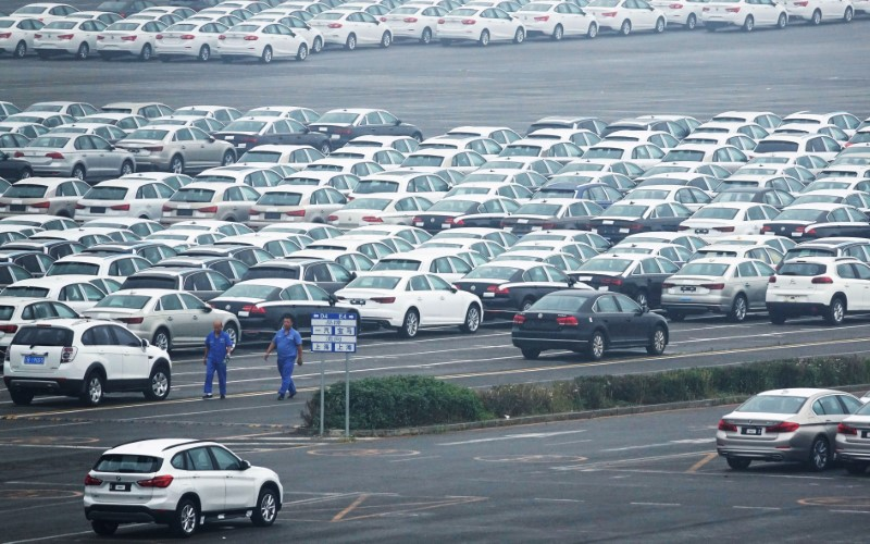 Newly manufactured cars are seen at the automobile terminal in the port of Dalian, Liaoning