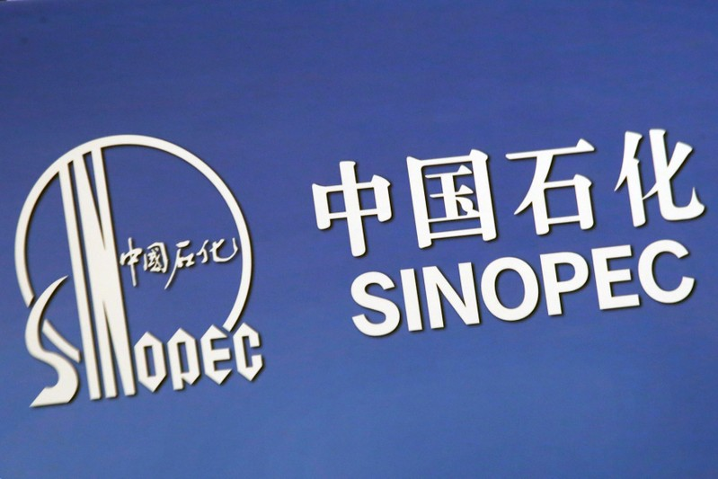 The company logo of China's Sinopec Corp is displayed at a news conference in Hong Kong