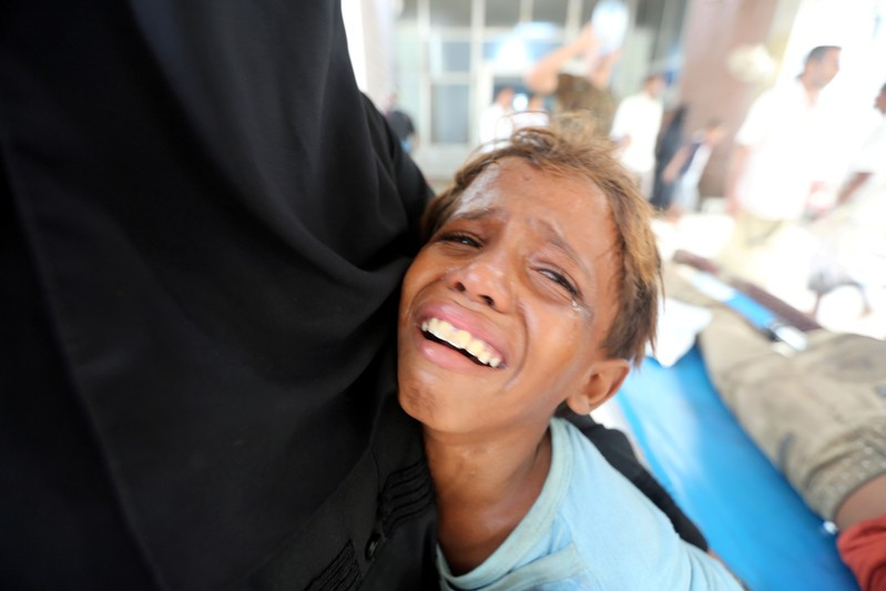 FILE PHOTO: Boy cries after his brother was injured in strike near al-Thawra Hospital in Hodeidah