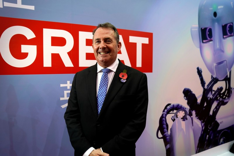 Britain's International Trade Secretary Liam Fox is interviewed by Reuters at the China International Import Expo (CIIE), at the National Exhibition and Convention Center in Shanghai