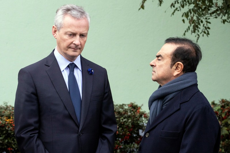 FILE PHOTO: French Economy Minister Bruno Le Maire and Renault CEO Carlos Ghosn wait for French President Emmanuel Macron for a visit of the Renault factory in Maubeuge