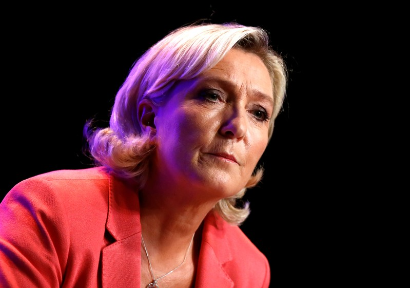 French far-right National Rally (Rassemblement National) party leader Marine Le Pen looks on as she delivers her speech in Mantes-la-Ville