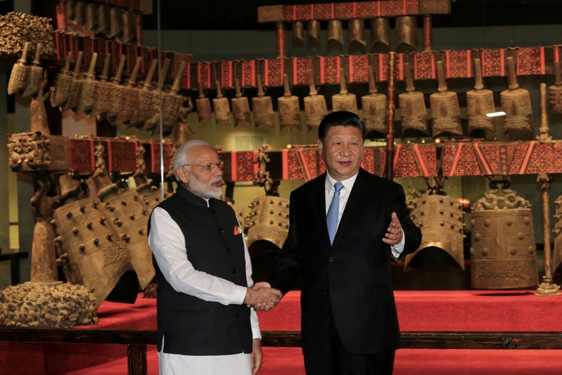 FILE PHOTO: Chinese President Xi Jinping and Indian Prime Minister Narendra Modi visit the Hubei Provincial Museum in Wuhan