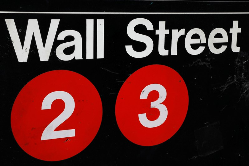 FILE PHOTO - A sign for the Wall Street subway station is seen in the financial district in New York
