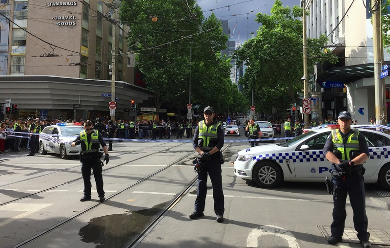 Policemen block members of the public from walking towards the Bourke Street mall in central Melbourne