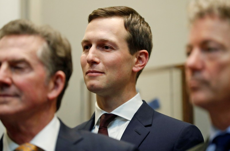 White House senior advisor Jared Kushner listens to U.S. President Donald Trump speak about the