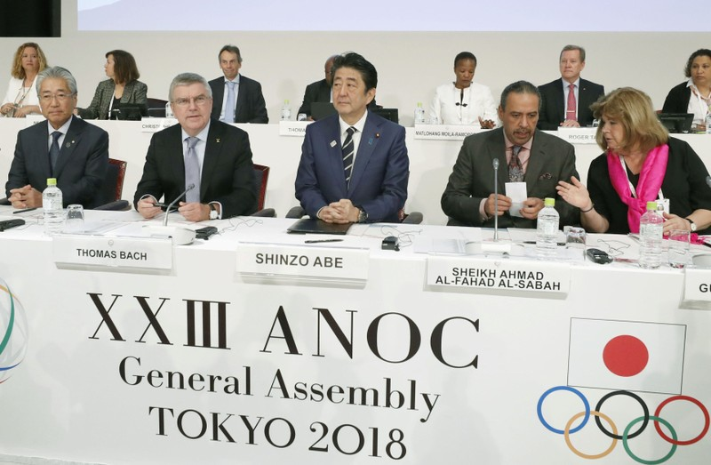 FILE PHOTO: IOC President Bach, Japan's PM Abe and ANOC President Al-Sabah attend the XXIII ANOC General Assembly in Tokyo