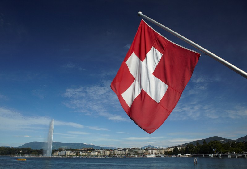 FILE PHOTO: Swiss flag is pictured next to Jet d'Eau and Lake Leman from the St-Pierre Cathedrale in Geneva