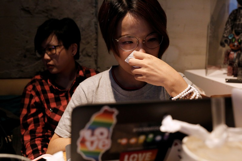 LGBT supporters cry after losing the referendum in Taipei