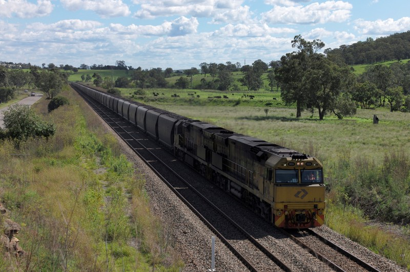 FILE PHOTO - An Aurizon coal train travels through the countryside in Muswellbrook, north of Sydney, Australia