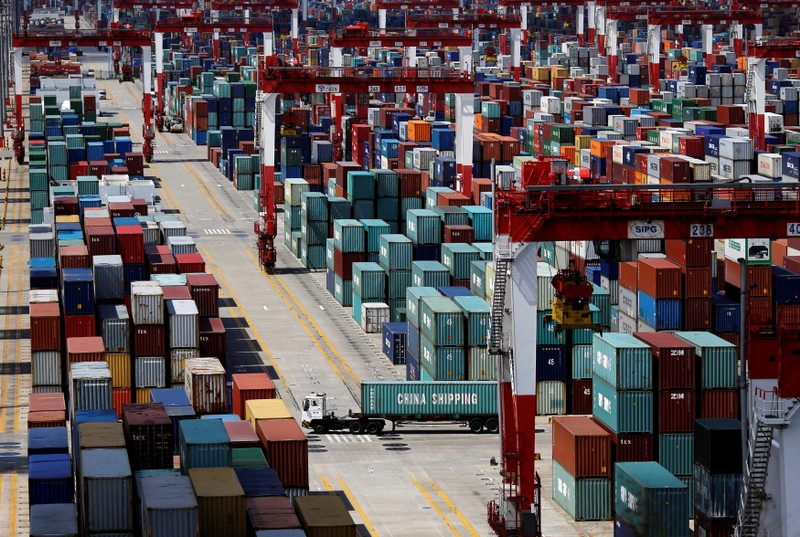 FILE PHOTO - A container truck drives in the container area at the Yangshan Deep Water Port, part of the newly announced Shanghai Free Trade Zone, south of Shanghai