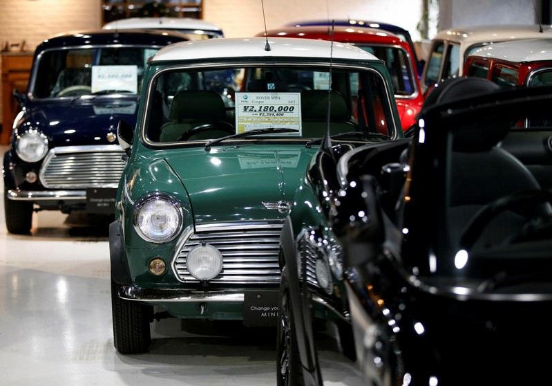 Rover Mini Cooper, Rover Mini Mayfair and Rover Mini Paul Smith cars are displayed at the showroom of the
