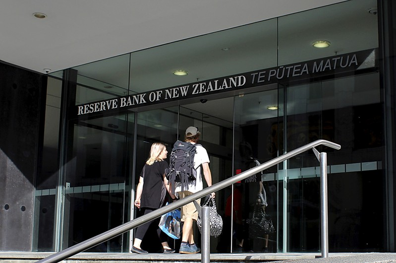 FILE PHOTO: Two people walk towards the entrance of the Reserve Bank of New Zealand located in the New Zealand capital city of Wellington