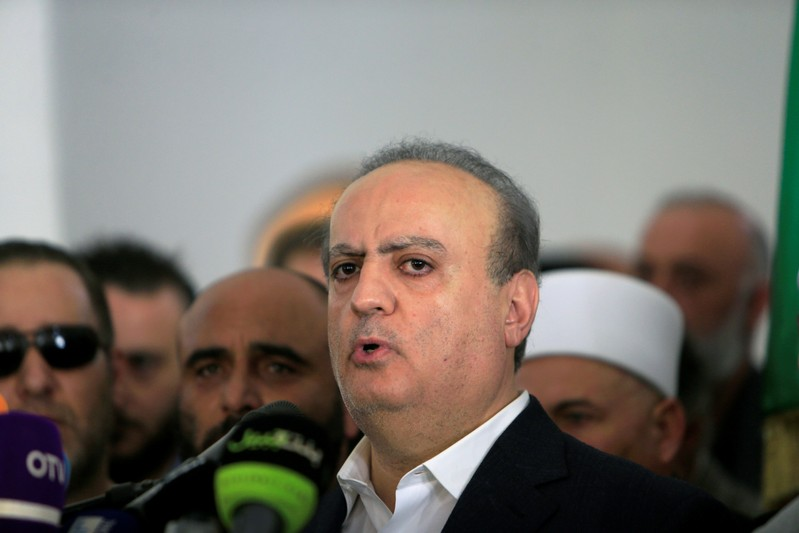 A pro-Syrian Druze politician Wiam Wahhab speaks during the funeral of his supporter in the village of al-Jahiliya