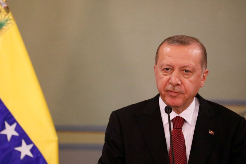 Turkish President Tayyip Erdogan speaks during a news conference after an agreement-signing ceremony between Turkey and Venezuela in Caracas