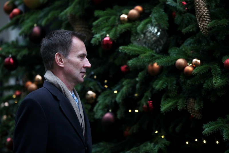 FILE PHOTO: Britain's Foreign Secretary Jeremy Hunt arrives in Downing Street, London
