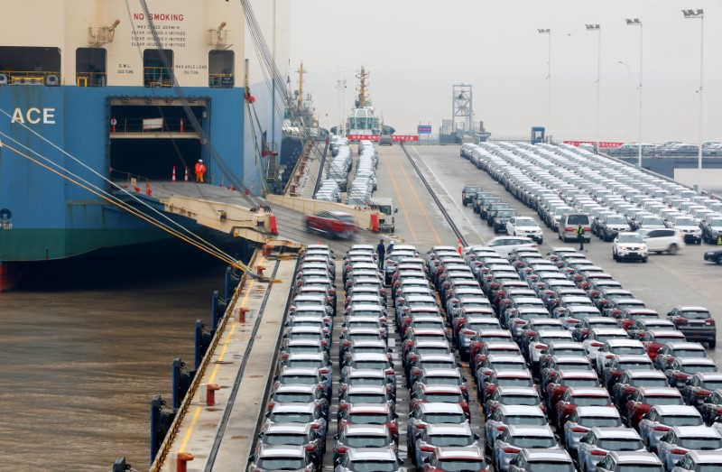 Geely cars for export enter a cargo vessel at Ningbo Zhoushan port