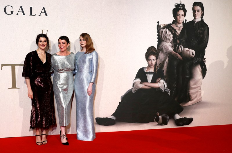 FILE PHOTO: Actors Rachel Weisz, Olivia Colman and Emma Stone pose at the UK Premiere of The Favourite during the London Film Festival