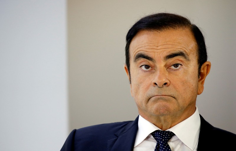 FILE PHOTO: Carlos Ghosn, chairman and CEO of the Renault-Nissan-Mitsubishi Alliance, attends a press conference on the second press day of the Paris auto show, in Paris