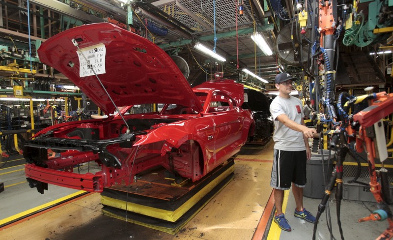 FILE PHOTO: The frame of a 2015 Ford Mustang vehicle moves down the production line at the Ford Motor Flat Rock Assembly Plant in Flat Rock, Michigan,