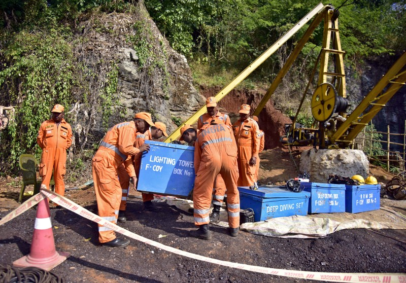 FILE PHOTO: Rescuers work at the site of a coal mine that collapsed in Ksan