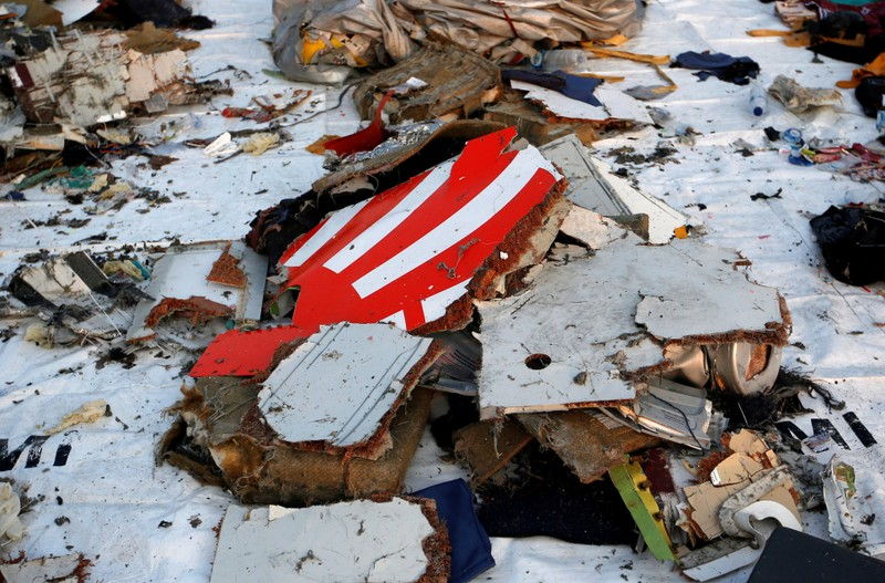 FILE PHOTO - Wreckage recovered from Lion Air flight JT610, that crashed into the sea, lies at Tanjung Priok port in Jakarta
