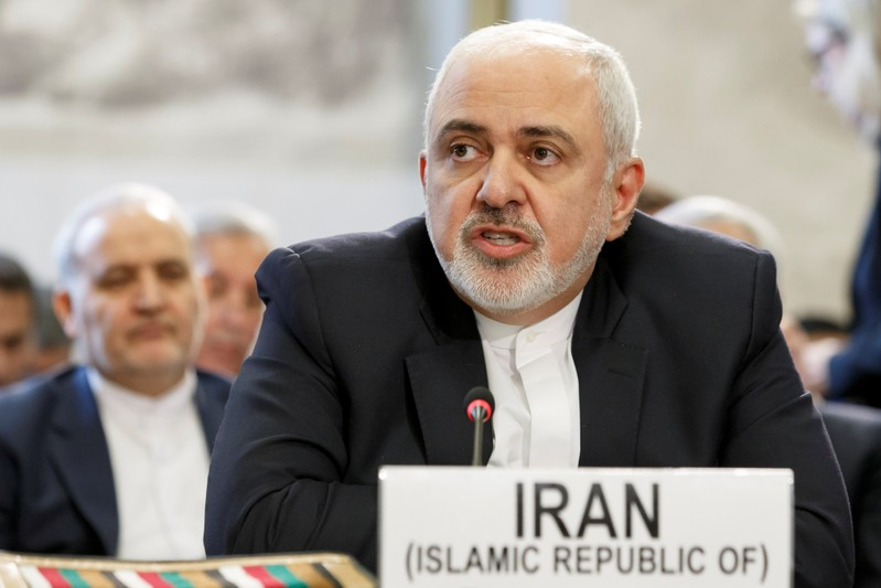 Iranian Foreign Minister Mohammad Javad Zarif delivers his statement, during the Geneva Conference on Afghanistan, at the European headquarters of the United Nations in Geneva