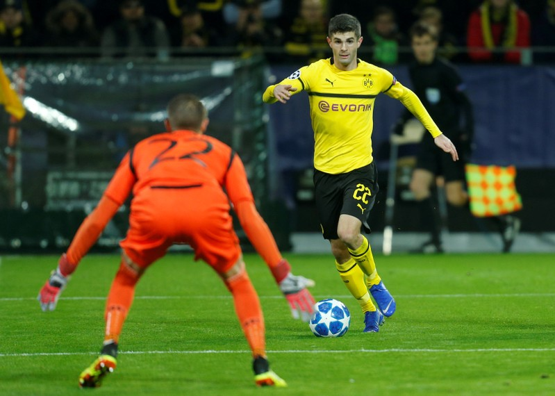 FILE PHOTO: Christian Pulisic in action for Borussia Dortmund