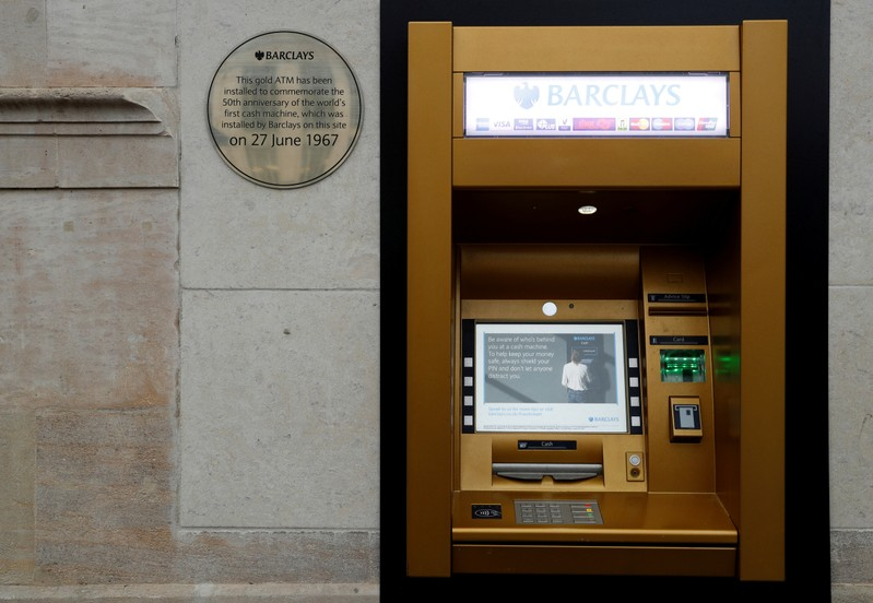 FILE PHOTO: A gold coloured ATM is seen as it commemorates the location of the world's first cash machine in London