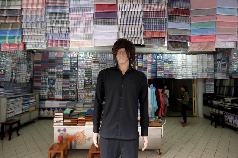 A garment shop is displayed along a street in Phnom Penh