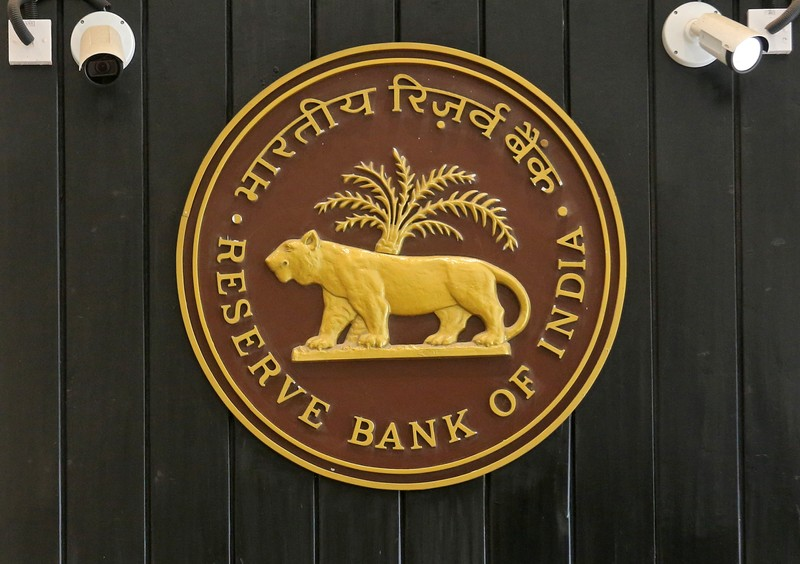 CCTV cameras are seen installed above the logo of Reserve Bank of India (RBI) inside its headquarters in Mumbai