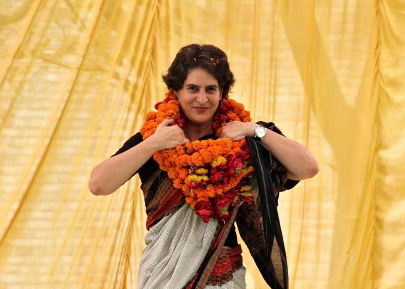 FILE PHOTO: Priyanka Gandhi Vadra adjusts her flower garlands during an election meeting at Rae Bareli